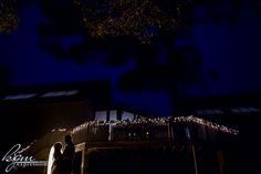 The bride and groom share an intimate moment behind the Noyes Museum, the deck bright with twinkle lights. #museumwedding #outdoorwedding  Photo by: http://www.kgmexpressions.com/