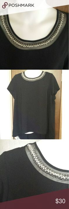 Dressy hi-lo plus size tunic by Lane Bryant 22-24 Beautiful beading on mesh inset is the main attraction of this simple, roomy black tunic with scoop neck, short sleeves, keyhole button closure at the back, and hi-lo hemline. Tag says fits size 22 to size 24. Like new. Lane Bryant Tops Tunics