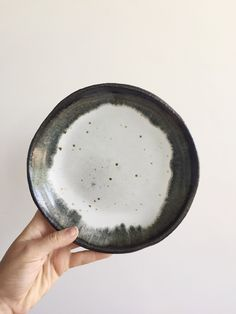 Image of Open bowl with black rim speckles raw exterior