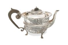 An Edwardian silver tea pot by George Nathan & Ridley Hayes, Chester 1906  (Qty)