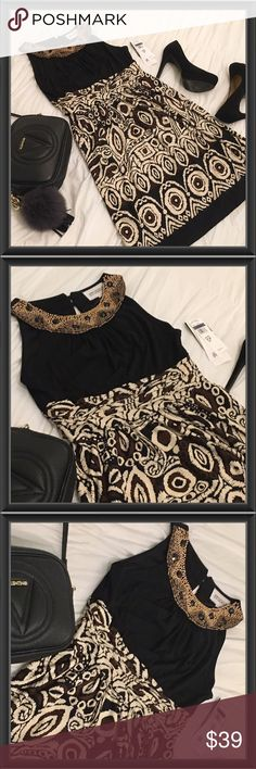 NWT Elegant Black & Tan Beaded Collar Dress NWT This dress is a beauty, it complements your body yet not tight, has a beautiful beaded collar, it's prefect for a night you want to feel elegant but still be comfortable. Studio 1  Dresses Mini