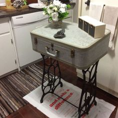 DIY Repurposed Furniture. Quirky and functional. Suitcase Table with a recycled old Singer Sewing Machine for legs