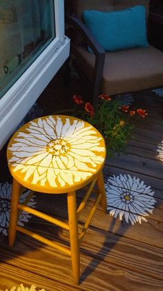 A wooden stool that has been stenciled with the Starburst Zinnia Flower Stencil from Cutting Edge Stencils. http://www.cuttingedgestencils.com/flower-stencils-starburst-zinnia-wall-art-stencil-floral.html