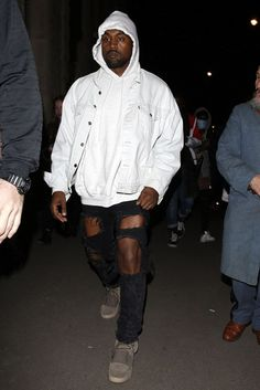 Kanye West wearing Levi's Vintage Trucker Jacket, Saint Laurent Custom Destroyed Skinny Jeans, Yeezy FW16 750 Boost