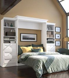 """Make the most of a smaller room using this surprisingly comfortable queen-sized wall bed, which is enclosed within two 25"""" storage units."""