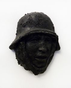 "Vladimir Anselm,""Soldier"" Sculpture in coal. Courtesy of the artist"