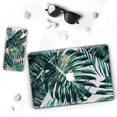 Jungle leaves SET Macbook and iPhone palm leaf @LovelyCasesDesign The case consists of two parts – transparent bottom part with all the ventilation and a printed top part. It provides a good protection from small skratches and damages. The print is durable and the colors are the same as on the picture. Hovewer, they can be made more pale or fresh if you want to. If you have your own idea – you will have it on your case! Just send me your photo in a good quality.