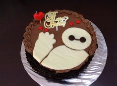 Baymax birthday cake. Chocolate chiffon cake with chocolate whipped cream, coated with Oreo crumbs. Baymax image cut out from a sheet of white cake.