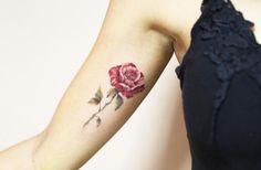 Underarm rose tattoo by Luiza Oliveira
