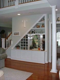 Love this built in wine rack & bookshelf!