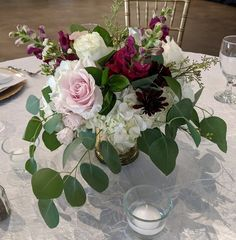 With hydrangeas, snapdragons, roses, and more in a gold mercury glass vase.