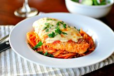 In this easy chicken Parmesan; Chicken is breaded in crackers then covered in a simple marinara, sprinkled with Parmesan and topped with mozzarella. Breaded Chicken Parmesan, Chicken Parmesan Recipes, Chicken Parmigiana, Cooking Recipes, Healthy Recipes, Top Recipes, Cheese Recipes, Easy Recipes, Italian Dishes