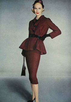 Sunny Harnett wearing a bell tunic suit in plum coloured wool tweed by Norman Norell, photographed by Irving Penn, Vogue, September 1957.