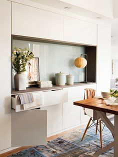 Instead of just a sideboard why not have a cabinet wall with an inset countertop in your dining area? Stylish storage.