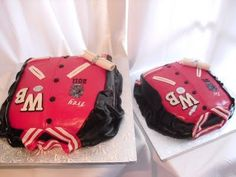 "Varsity Jacket Graduation Cakes!  Two cakes done for a client whose twin sons were celebrating their high school graduation. Winder Barrow High School varsity letterman jackets with custom track and field, football and basketball ""pins"" . One red velvet, on french vanilla."
