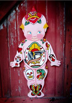 Custom Designed Hand Carved Hand Painted Traditionaly Tattooed Kewpie Doll Wood Cut Plaque. $300.00, via Etsy.