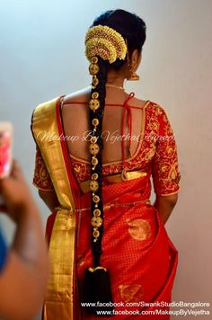 Traditional Southern Indian bride's bridal braid hair. Hairstyle by Swank Studio. Silk Saree. Sari Blouse Design. Hair Accessory. Temple jewelry. Jhumkis. Silk kanchipuram sari. Braid with fresh flowers. Tamil bride. Telugu bride. Kannada bride. Hindu bride. Malayalee bride. Find us at https://www.facebook.com/SwankStudioBangalore
