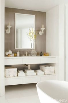 """<span>""""A lot of people say they've never seen anything like it in Boston,"""" the owner says. """"It's a more California style—very finished, but also very informal.""""</span><br /><br /><strong><em>Tub, MTI Baths. Sink fittings, Gessi. Sconces, Jasper.</em></strong>"""