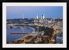 """Cityscape of """"Azerbaijan, Baku, looking towards The Baku Business Center"""" by Jane Sweeney, featured as a Framed Print. Check it out at GreatBIGCanvas.com."""