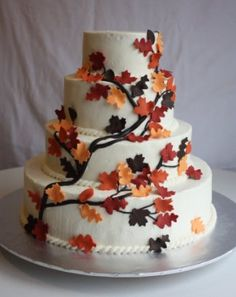 Love the idea of working Fall leaves into the cake. maybe a little less, but add the ribbon/band to separate the layers