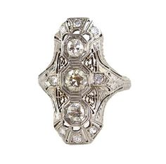 Filigree Art Deco diamond ring I have a ring very similar to this. It's uncomfortable to wear but nice to look at.