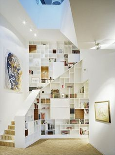 Stair shelves and unconventional storage spaces around your stairs are clever ways to declutter you home. Bookcase Stairs, Stair Shelves, Staircase Storage, Stair Storage, Bookshelves, Library Shelves, Book Staircase, Bookshelf Wall, Staircase Landing