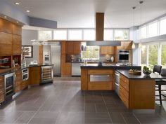 contemporary-kitchen-island-design-features-dark-gray-island-countertop-and-maple-oak-wood-kitchen-cabinet-drawers-in-modern-kitchen-with-square-basket-parquet-pattern-ceramic-tiles-flooring-with-roll-1138x855.jpg 1,138×855 pixels