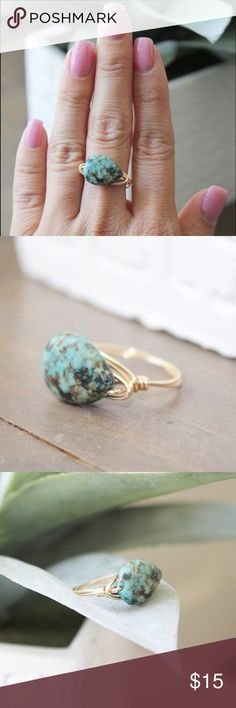 HANDMADE African Turquoise Wire Wrapped Ring An African turquoise stone with a vibrant and unique hue, wire wrapped as a ring. The wire wrapping style is certainly meant to be a little imperfect, making each ring unique to its owner. I also have sterling silver wire available, please leave a note at checkout if you would like this ring in silver.  The wire used for this ring is gold plated wire over copper, it is tarnish resistant and holds up to everyday wear amazingly. LucyMint Jewelry…