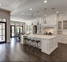 Beautiful all white kitchen and love the contrasting wood floors.