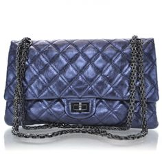 5915cf150483 This is an authentic CHANEL Calfskin 2. 55 Reissue 226 Flap in Metallic  Blue This