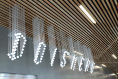 Get crafty and use light BULBS to design your signage Signage Display, Retail Signage, Wayfinding Signage, Signage Design, Signage Board, Environmental Graphic Design, Environmental Graphics, Stand Feria, Grafik Design