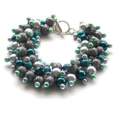 This type of bracelet makes me think..... Bubbles! Silver, Grey and Shades of Teal.