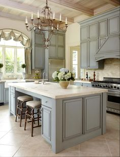 Gray cabinets, marble, coffered ceiling, window treatment...