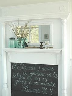 Faux Fireplace Design - this one basically just looks like a wall shelf, with a rectangle of chalkboard paint below, mirror above. simple and nice. i want a mantle to decorate!