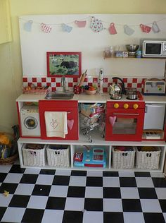 Play kitchen. Built my the hubster, designed by me!  All Ikea and super cheap base units.  Gets heaps of play and plenty of room at playdates!
