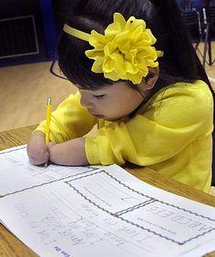 Girl born without hands wins penmanship award
