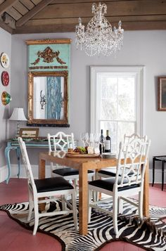 Breakfast room chairs, antiqued blue console table with lamp, mirror above console table, rug placement