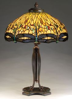 Tiffany's Lamps..................Bought myself a red one of these for my 50th BD a couple years ago.