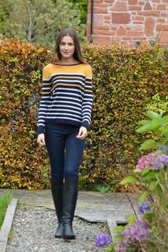 Happy Kinda Life - We love this round neck jumper in our soft cotton blend yarn. Soft grey colour with sophisticated navy stripes and just a pop of colour in the yellow stripes, enough to brighten up many a winter's day. Long sleeved with a small rib on cuffs and at hem.