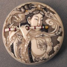 Netsuke depicting a woman playing a flute : Japanese, 1959.