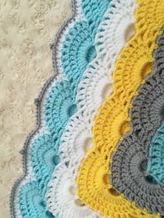Love this pattern! First time for me in square format and I think I worked out well.  Finished the edge with two half double crochets in the spaces and just one either side of a drop half double in...
