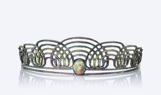 Solange Rainbow headband A graduating series of interlocking semi circles all pave set with a rainbow array of HPHT treated Diamonds Rubies and Pink Sapphires with a rub over set oval black Opal to the centre.