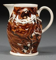 Mochaware Marbled Slip Decorated Jug, Britain, c. 1780, baluster-form jug slip marbled in dark brown, rust, and white with sprigged whi
