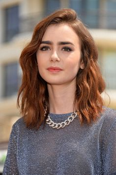 Lily Collins promoting 'Mortal Instruments.' Makeup by Kayleen McAdams.