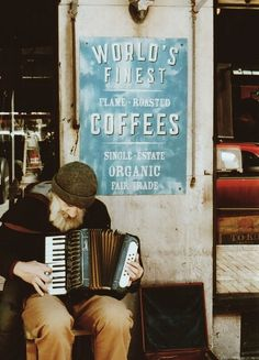The most known man with the most neglected soul. Here he is playing outside of the most popular coffee shop to gather, where all are welcome. Literally. All. And still, he plays on. Passion.
