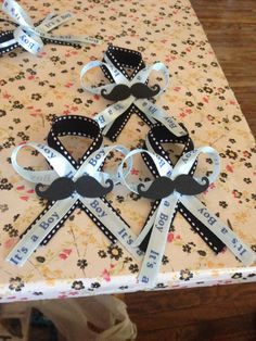 Baby shower mustache pins for guests
