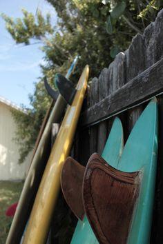 Wood boards up against a fence. Via ૐ I'm a rhino ૐ (http://shynotherhino.tumblr.com/post/71944572469).