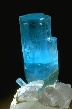 blue beryl crystal on microcline from the National Mineral Collection