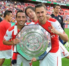 Ramsey, with Santi Cazorla and Tomas Rosicky, is eager for more silverware. #COYG