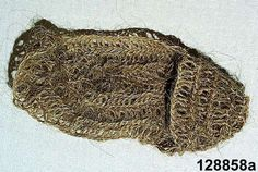 """Skosockor (shoe sock); nalbound spun horsehair; Sock worn between the sock and shoe in winter to keep warm (e.g. forest work during severe cold). Was still in common use 1915-16. Made by Hansback Anna Persdotter from Näset, Älvdalen about 1915.  """"Tagelsockor""""/""""Skosockor"""" are known by other names in other places in Sweden. In Jämtland they are called """"skotälingar""""."""